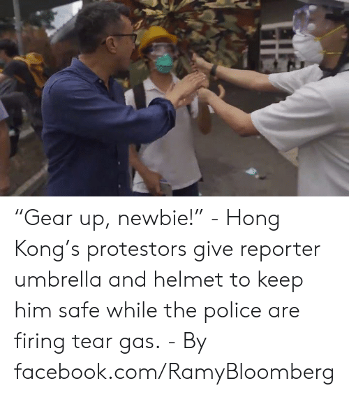 """Dank, Facebook, and Police: """"Gear up, newbie!"""" - Hong Kong's protestors give reporter umbrella and helmet to keep him safe while the police are firing tear gas. - By facebook.com/RamyBloomberg"""