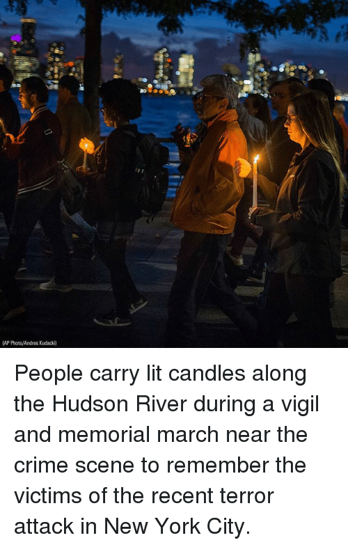 in-new-york-city: 13 1  AP Photo/Andres Kudacki) People carry lit candles along the Hudson River during a vigil and memorial march near the crime scene to remember the victims of the recent terror attack in New York City.