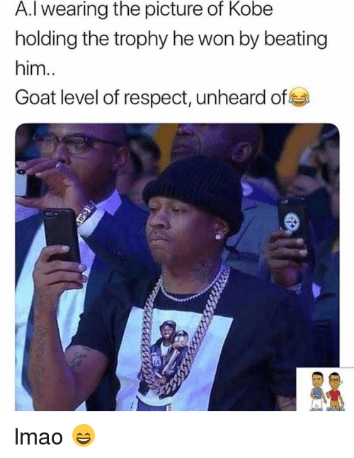 Lmao, Respect, and Sports: A.I wearing the picture of Kobe  holding the trophy he won by beating  him  Goat level of respect, unheard of lmao 😄