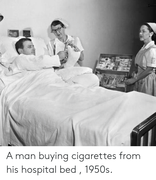 Hospital, Man, and Cigarettes: A man buying cigarettes from his hospital bed , 1950s.