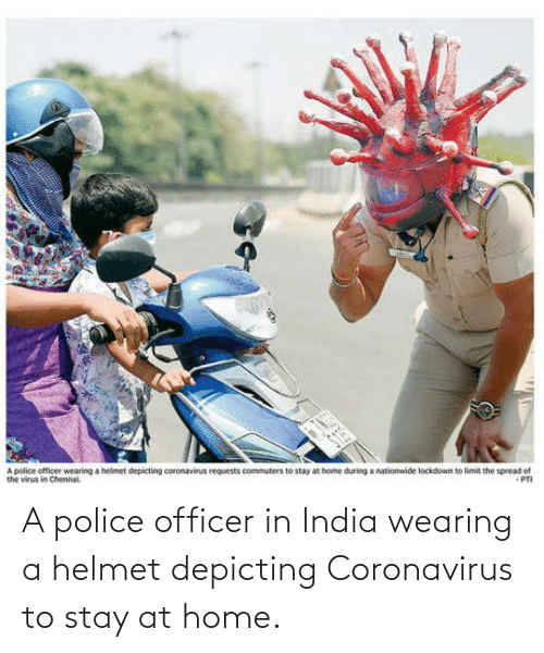 police officer: A police officer in India wearing a helmet depicting Coronavirus to stay at home.