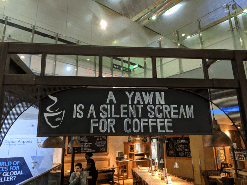 Scream, Coffee, and World: A YAWN  IS A SILENT SCREAM  FOR COFFEE  oybai Airports  HOT TEA  Brussels Breaifast  Moroccan Mint  Connecting the World  ced Organic Coffee artGrey Cnill  Iced Care Latte  oed Organic Tea  ced Lemonade  Iced Mint Lenona  Capp  RLD OF  CES FOR  GiLOBAL  LLER?