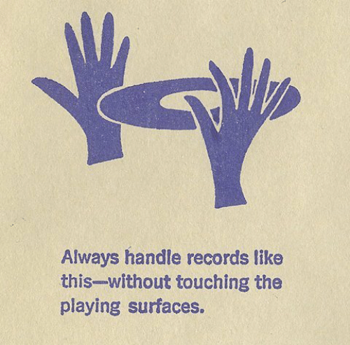 Records, Handle, and This: Always handle records like  this-without touching the  playing surfaces.