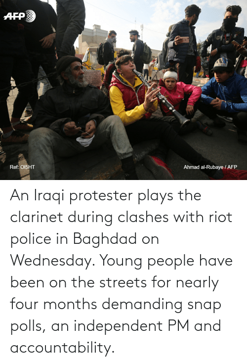 Iraqi: An Iraqi protester plays the clarinet during clashes with riot police in Baghdad on Wednesday. Young people have been on the streets for nearly four months demanding snap polls, an independent PM and accountability.