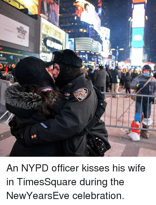 Memes, Nypd, and Wife: An NYPD officer kisses his wife in TimesSquare during the NewYearsEve celebration.