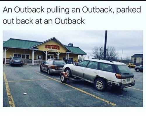 pulling: An Outback pulling an Outback, parked  out back at an Outback  OUTBACK
