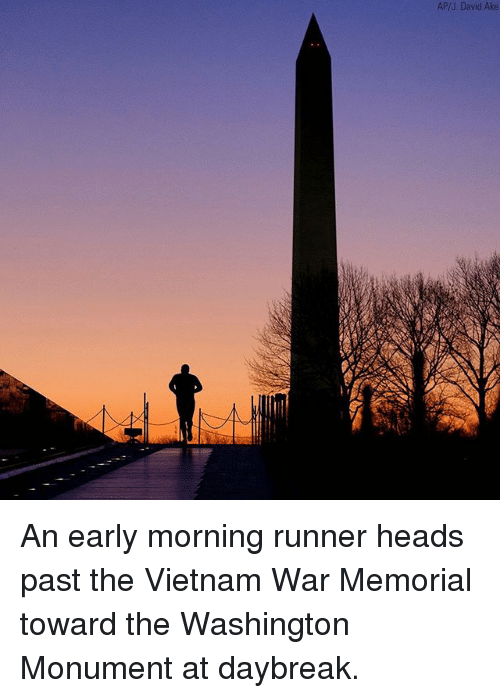 Memes, Vietnam, and 🤖: AP/J. David Ake An early morning runner heads past the Vietnam War Memorial toward the Washington Monument at daybreak.