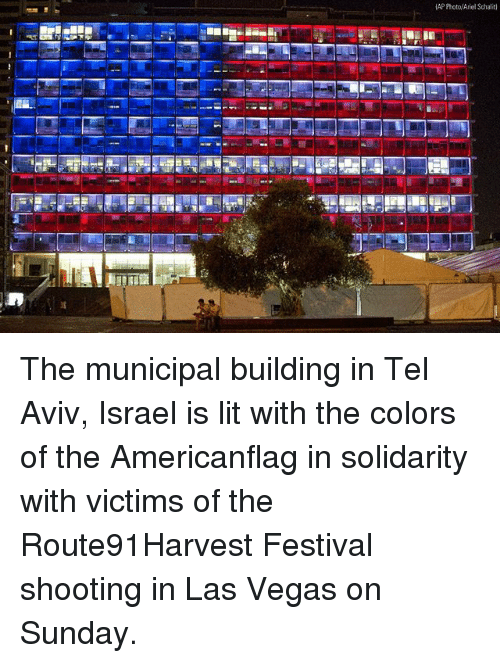 Ariel, Lit, and Memes: AP Photo/Ariel Schalit) The municipal building in Tel Aviv, Israel is lit with the colors of the Americanflag in solidarity with victims of the Route91Harvest Festival shooting in Las Vegas on Sunday.