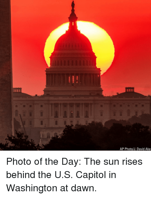 Memes, Dawn, and 🤖: AP Photo/J. David Ake Photo of the Day: The sun rises behind the U.S. Capitol in Washington at dawn.