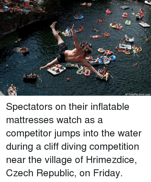 czech: AP Photo/Petr David Josek Spectators on their inflatable mattresses watch as a competitor jumps into the water during a cliff diving competition near the village of Hrimezdice, Czech Republic, on Friday.