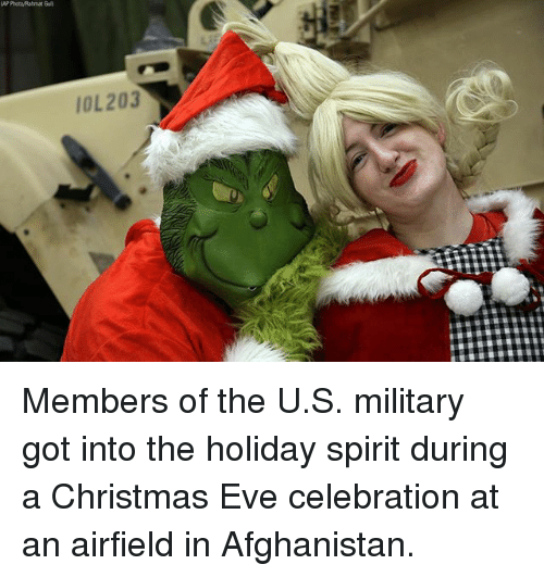 Christmas, Memes, and Afghanistan: AP Photo/Rahmat Gul)  IOL203 Members of the U.S. military got into the holiday spirit during a Christmas Eve celebration at an airfield in Afghanistan.