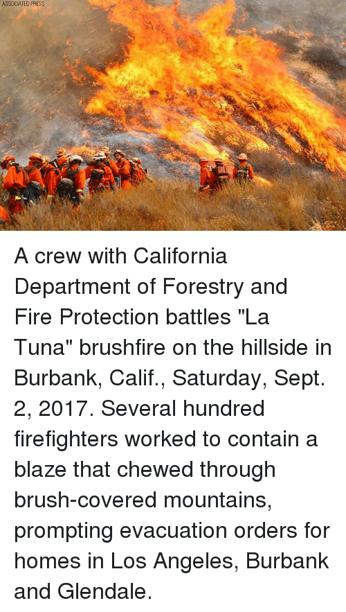 """containment: ASSOCIATED PRESS A crew with California Department of Forestry and Fire Protection battles """"La Tuna"""" brushfire on the hillside in Burbank, Calif., Saturday, Sept. 2, 2017. Several hundred firefighters worked to contain a blaze that chewed through brush-covered mountains, prompting evacuation orders for homes in Los Angeles, Burbank and Glendale."""
