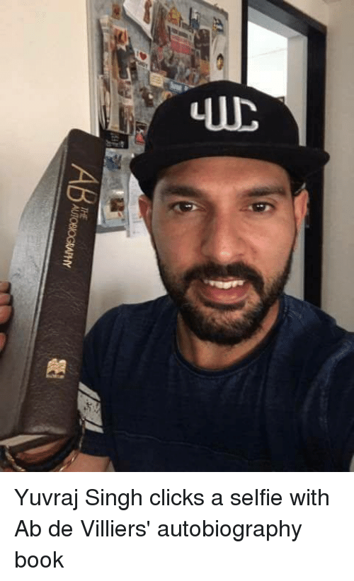 Memes, Selfie, and Book: AT es  AB  UTOBIOGRAPHY Yuvraj Singh clicks a selfie with Ab de Villiers' autobiography book