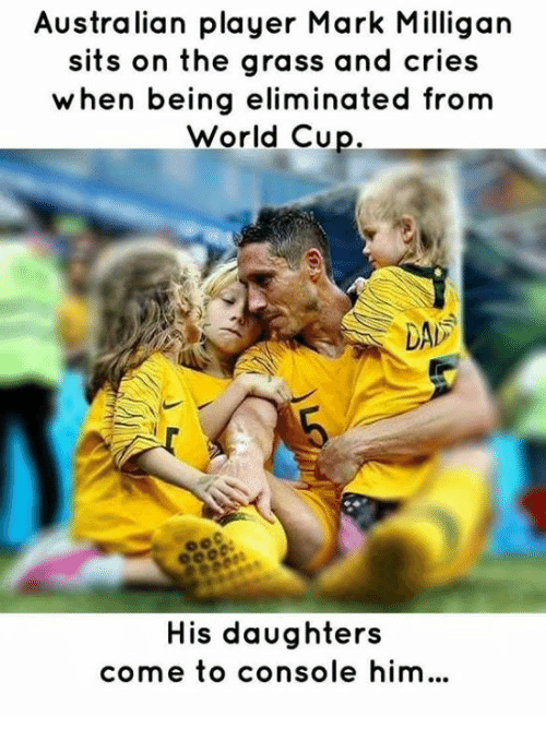 Dad, World Cup, and World: Australian player Mark Milligan  sits on the grass and cries  when being eliminated from  World Cup.  DAD  His daughters  come to console him.