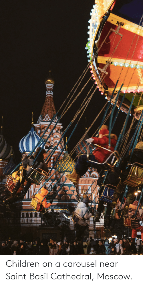 Children: Children on a carousel near Saint Basil Cathedral, Moscow.