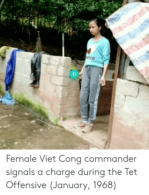 Charge, Viet Cong, and Commander: Female Viet Cong commander signals a charge during the Tet Offensive (January, 1968)