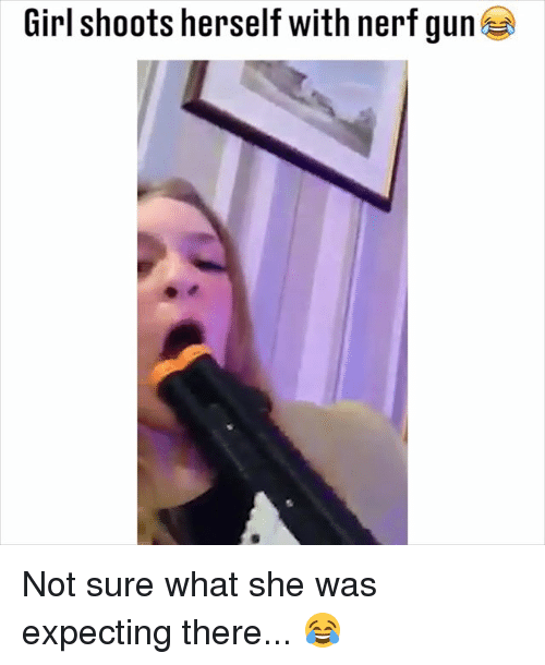 nerf gun: Girl shoots herself with nerf gun Not sure what she was expecting there... 😂