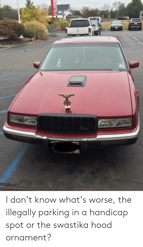 swastika: I don't know what's worse, the illegally parking in a handicap spot or the swastika hood ornament?