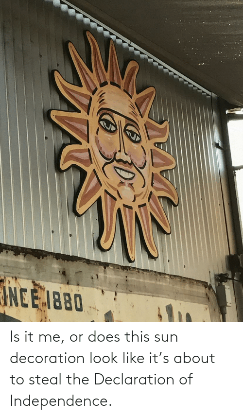 Does: Is it me, or does this sun decoration look like it's about to steal the Declaration of Independence.
