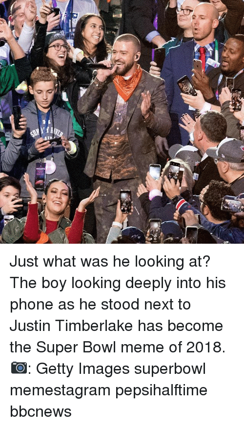 Justin TImberlake, Meme, and Memes: Just what was he looking at? The boy looking deeply into his phone as he stood next to Justin Timberlake has become the Super Bowl meme of 2018. 📷: Getty Images superbowl memestagram pepsihalftime bbcnews