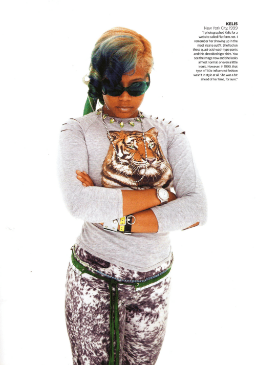 "York City: KELIS  New York City, 1999  ""I photographed Kelis for a  website called Platform.net. I  remember her showing up in the  most insane outfit. She had on  these quasi-acid-wash-type pants  and this shredded tiger shirt. You  see the image now and she looks  almost normal, or even a little  ironic. However, in 1999, that  type of '80s-influenced fashion  wasn't in style at all. She was a bit  ahead of her time, for sure."""
