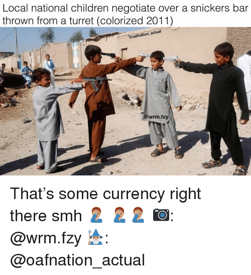 Children, Memes, and Smh: Local national children negotiate over a snickers bar  thrown from a turret (colorized 2011)  @oafnation actual  @wrm.fzy That's some currency right there smh 🤦🏽♂️ 🤦🏽♂️🤦🏽♂️ 📷: @wrm.fzy 🧙🏽♂️: @oafnation_actual