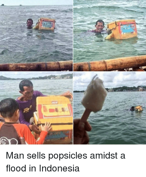 Indonesia: Man sells popsicles amidst a flood in Indonesia