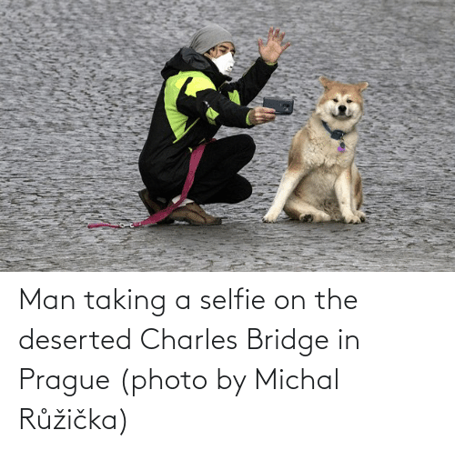 Prague: Man taking a selfie on the deserted Charles Bridge in Prague (photo by Michal Růžička)