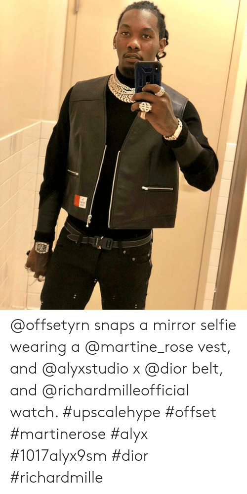 Snaps a Mirror Selfie Wearing a Vest and X Belt and Watch