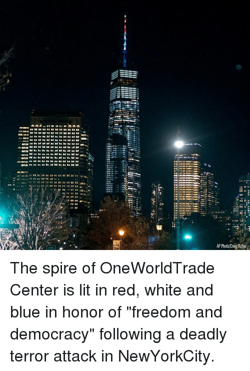 """freedom-and-democracy: P Photo/Crag Ruttle The spire of OneWorldTrade Center is lit in red, white and blue in honor of """"freedom and democracy"""" following a deadly terror attack in NewYorkCity."""
