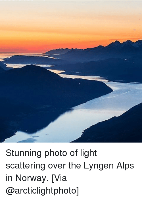 Memes, Norway, and 🤖: Stunning photo of light scattering over the Lyngen Alps in Norway. [Via @arcticlightphoto]
