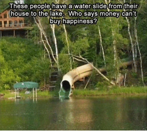 lakings: These people have a water slide from their  house to the lake. Who says money can't  buy happiness?