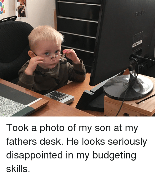 Disappointed, Funny, and Desk: Took a photo of my son at my fathers desk. He looks seriously disappointed in my budgeting skills.