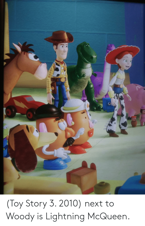 Next To: (Toy Story 3. 2010) next to Woody is Lightning McQueen.