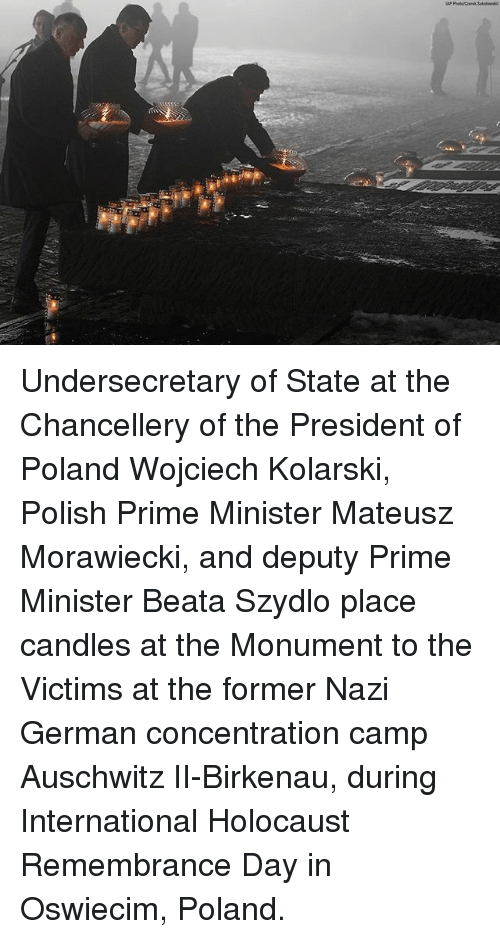 Memes, Auschwitz, and Holocaust: Undersecretary of State at the Chancellery of the President of Poland Wojciech Kolarski, Polish Prime Minister Mateusz Morawiecki, and deputy Prime Minister Beata Szydlo place candles at the Monument to the Victims at the former Nazi German concentration camp Auschwitz II-Birkenau, during International Holocaust Remembrance Day in Oswiecim, Poland.