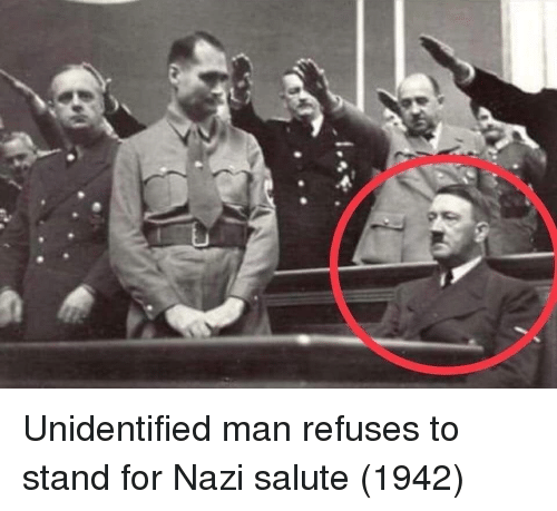 Nazi, Man, and For: Unidentified man refuses to stand for Nazi salute (1942)