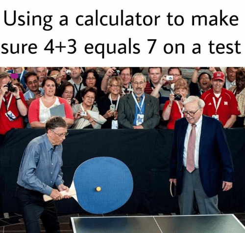 Equals: Using a calculator to make  sure 4+3 equals 7 on a test