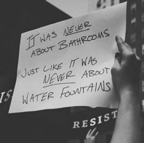 Water, Never, and Like: WAS NEUER  ABOUT BATHROOMS  JusT LIKE IT WAS  NEVER ABOUT  WATER FouNTAIS  RESIST