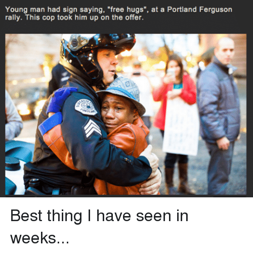 "free hug: Young man had sign saying, ""free hugs"", at a Portland Ferguson  rally. This cop took him up on the offer. Best thing I have seen in weeks..."
